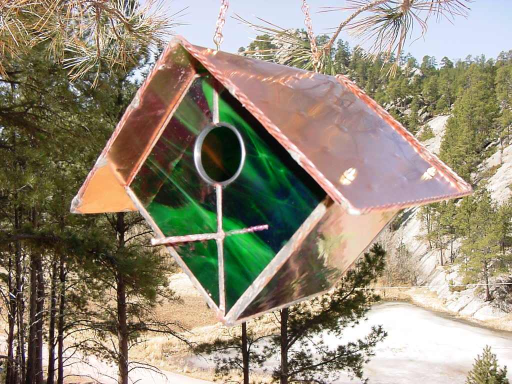 Green and White Stained Glass Bird House